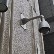 security camera over city block-future of converged security